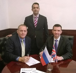 Mark Viner (left) signs the MOU with Pavel Nazarov. Standing by is Asim Ansari, Airedale's global key accounts manager