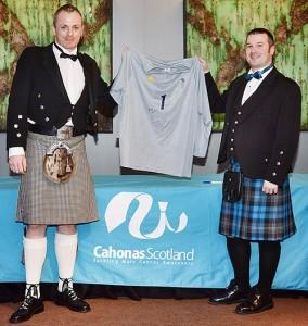 Darrel Birkett, left, presents George Pinner's shirt to Ritchie Marshall of Cahonas Scotland