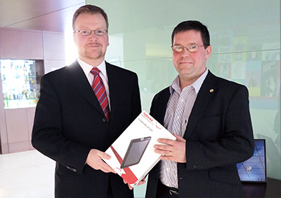 Angus Cameron of CDL Scotland presents tablet to Graeme Fox