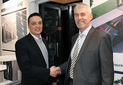 Matt McBurney (left), vice president commercial products group, Modine Manufacturing, seals the deal with Barry Phillips, Barkell co-founder and director