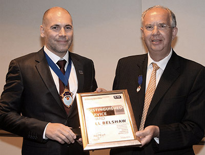 Bill Belshaw (right) receives his Distinguished Service Award from B&ES president