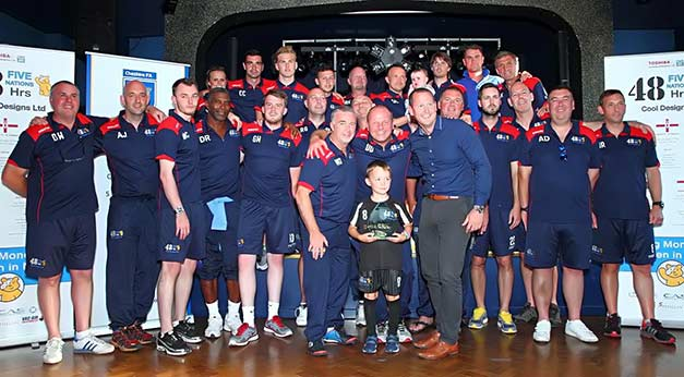 Squad-and-ballboy-presented-with-trophy-by-the-FA