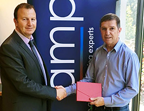 AMP regional sales manager Lloyd Grimes (left) presents a prize of a luxury weekend break for two to Simon Jenson, contracts manager at Quantech Environmental
