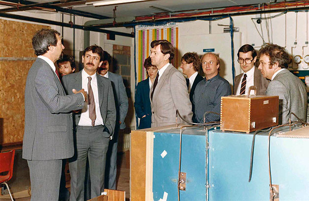 Roy (far left) conducts a tour of the IMI factory.  (Photo kindly supplied by Steve Glover of the Air Conditioning Agency)